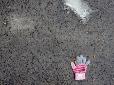The lost glove of a small child. The concept of protecting children and the importance of their social adaptation.