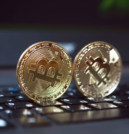 Bitcoin coin symbol on laptop, future concept financial currency, crypto currency sign. BTC coin as symbol of electronic virtual money. Banco de Imagens