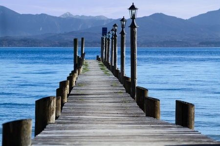 Jetty at lake Chiemsee in autumn photo