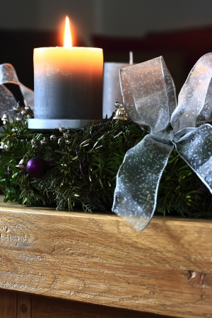Advent wreath with burning candle photo