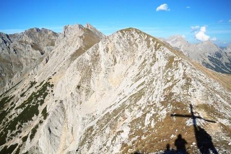 Brunnstein peak with hikers as shadows; Austria photo
