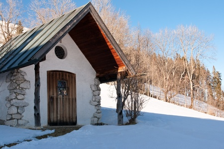 Mountain chapel in the bavarian alps in winter photo