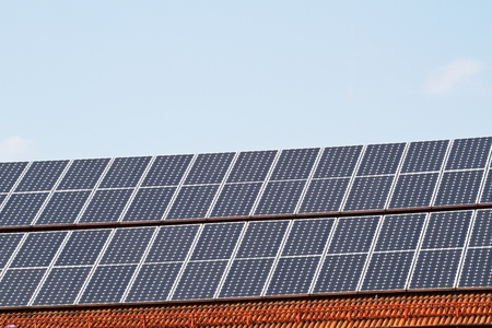 energy suppliers: Solar Cells on a brick roof in Bavaria Stock Photo