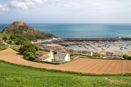 jerseys: View to Mont Orgueil Castle with harbour in Gorey, Jersey, UK