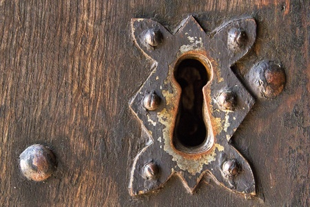 antique keyhole: Old door lock Stock Photo