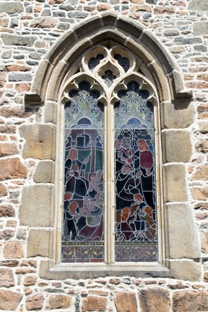 Historic church window with glass from outside photo