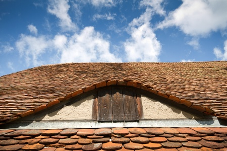Old tiled roof with attick window photo