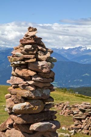 Stone man in the italian alps  photo