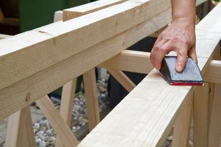 manually: Manually grinding a wooden beam