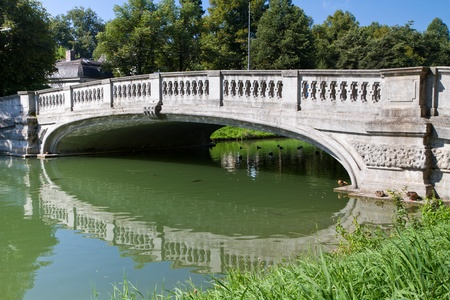 """nymphenburg palace: Stone bridge crossing the """"Nymphenburg"""" canal in Munich, Germany"""