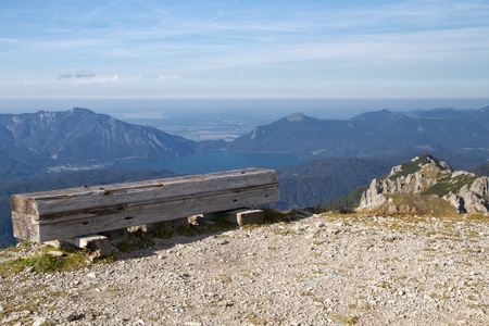 Resting bench in the bavarian alps, Germany, with view to lake