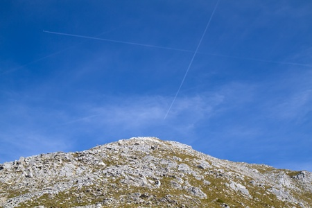 vapour: Two vapour trails in the bavarian alps, Germany Stock Photo