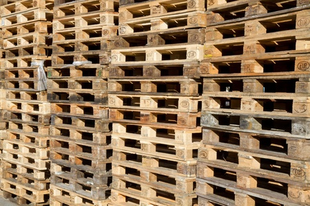 euro pallet: Pallets stacked in a pile outside Stock Photo