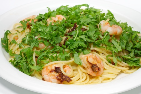 Spaghetti with shrimp and rucola photo