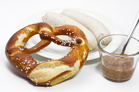 Fresh Bavarian white sausage, pretzel and mustard photo
