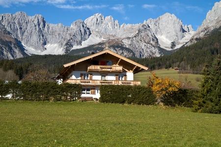 """Farmhouse at """"Zahmer Kaiser"""" mountains in Tyrol, Austria photo"""