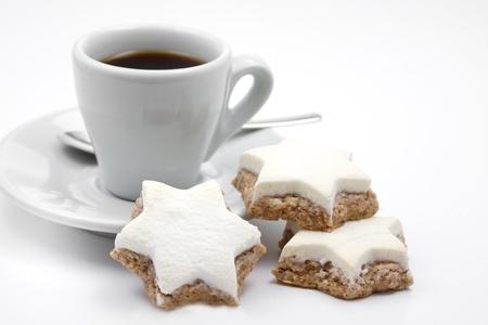 Cinnamon stars christmas cookies with espresso cup Standard-Bild