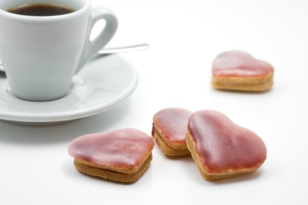 Pink heart shaped christmas cookies with espresso cup photo