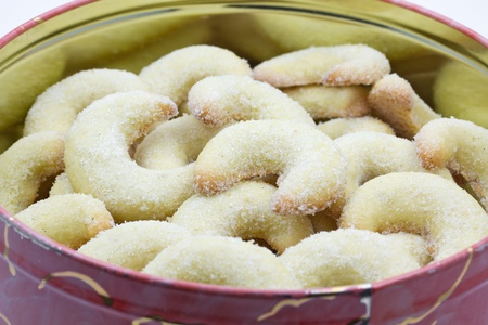 Vanilla crescent christmas cookies in a tin photo