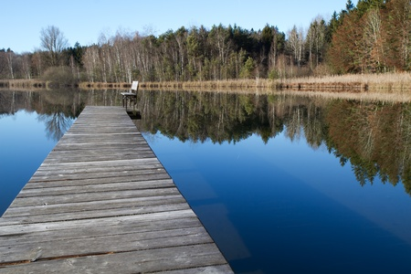 lonelyness: Wooden Jetty on a bathing lake in Bavaria, Germany