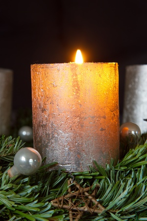 Advent wreath with one burning candle photo