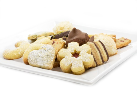 Selection of christmas cookies on a white plate photo
