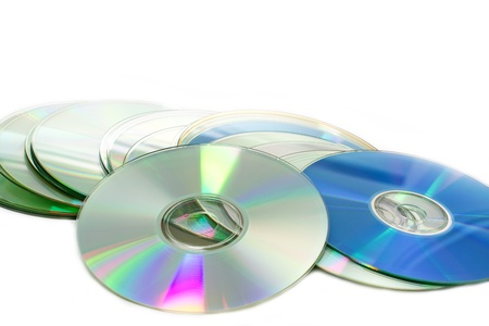 pirated: Pile of Compact Discs (CDs) on white background