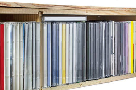 pirated: Collection of Compact Discs (CDs) in a shelf Stock Photo