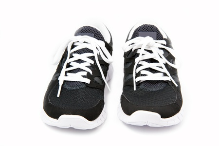 Black and white sport shoes on white background photo