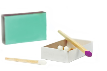violett: Short matches in a box and one violett coloured on top of it Stock Photo