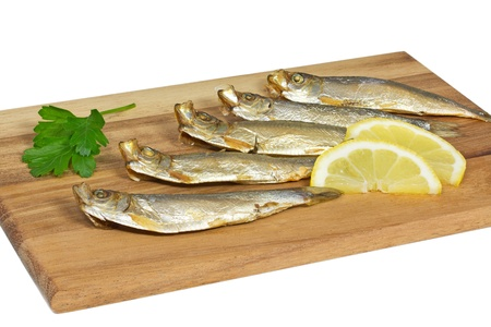 sprats: Some sprats on a wooden board