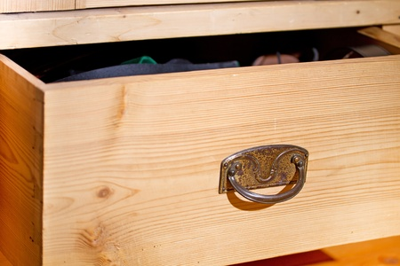 Open wooden drawer with handle photo