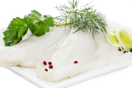 Two Halibut fillets on a white plate Stock Photo