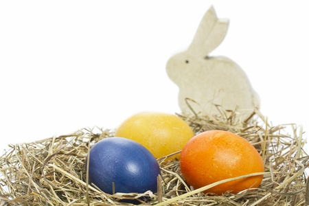 Hand painted easter eggs with bunny in a basket on white Stock Photo - 13235282