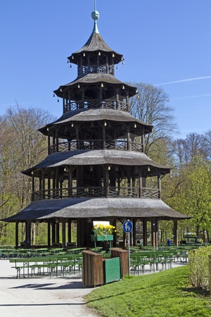 The historic  Chinesischer Turm  tower of Munich, Bavaria, Germany, with beer garden photo