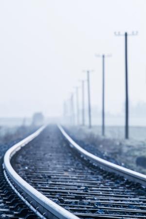 Railway line in morning fog in rural Bavaria, Germany photo