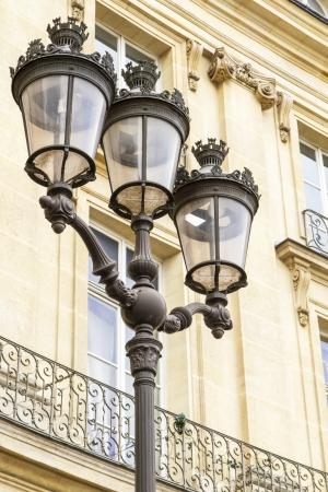 Metallic retro lamppost in Paris, France photo