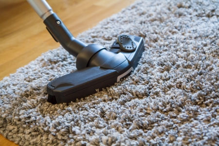 vacuuming: Vacuum cleaner to tidy up the living room Stock Photo