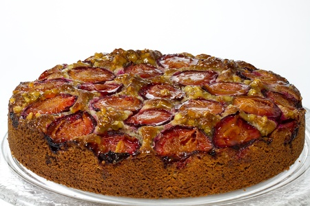 made in germany: Home made German plum cake with walnuts on white