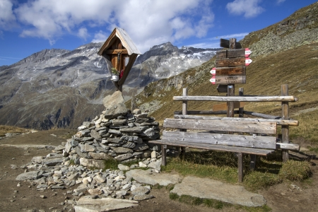 wayside: Wayside shrine and bench in the mountains of northern italy