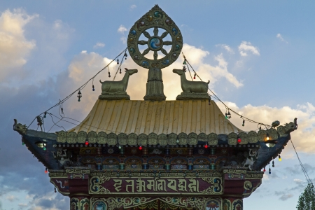 Decoration on the roof of a temple in Leh, Ladakh, in warm evening light Stock Photo - 16332825