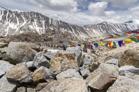 Tibetan prayer flags in Ladakh, India, seen on top of Khardung La Pass Stock Photo - 16430573