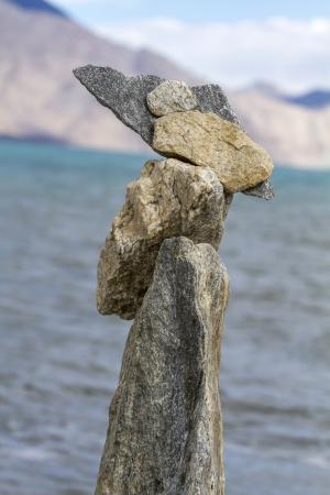 Stack of stones balancing on a lake background Stock Photo - 16430753