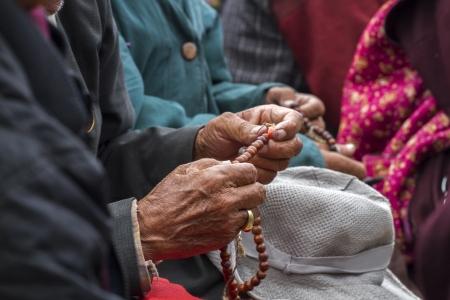 god s hand: Ladakhi holding wooden rosary beads, Ladakh, India