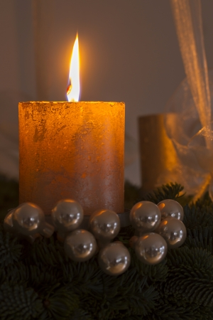 Advent wreath with one burning candle inside a home photo