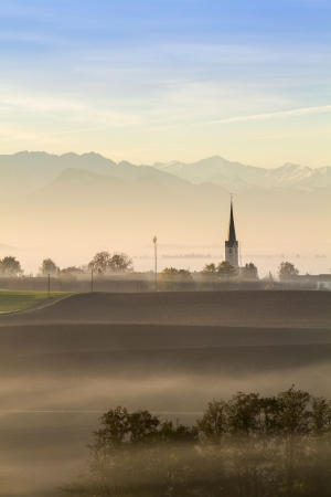 Early morning in the bavarian countryside, Germany, with view to the alps photo