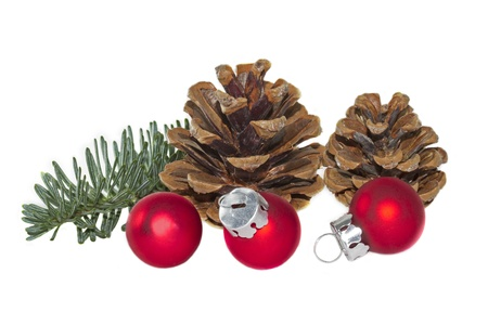 Red christmas balls with pinecones and fir twig photo