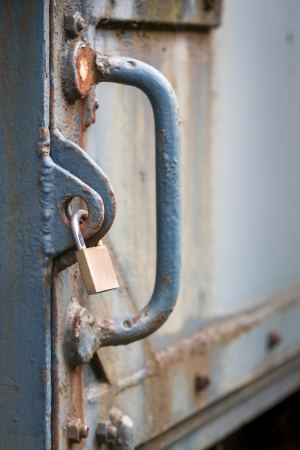 Locker securing old heavy iron door photo