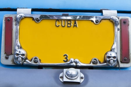 license plate: Yellow vintage numberplate on Cuba