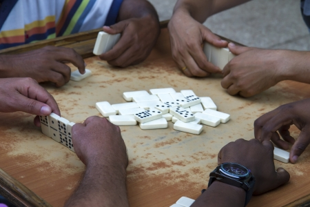 Playing domino on Cuba photo
